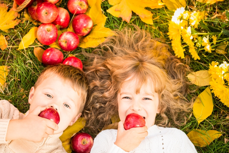 Eating apples outdoors puts a fun fall twist on snack time.